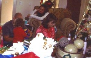 Ryan playing with Kerianne on the floor at Christmas. Jennifer on couch.